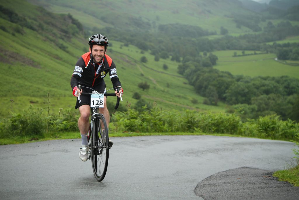 Tobias Mews cycling up Hardknott Pass