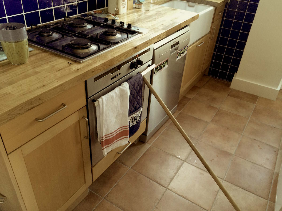 Our old oven door needs the help of a broom stick to keep the warmth in - essential for baking cakes!